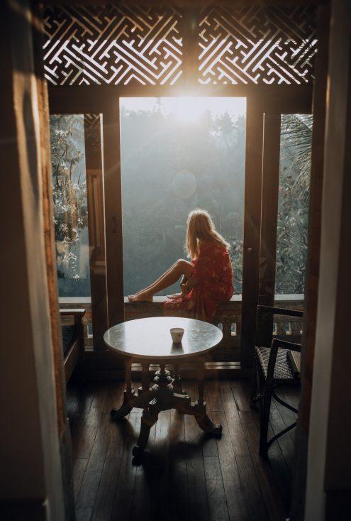 stock image of girl sitting on a balcony