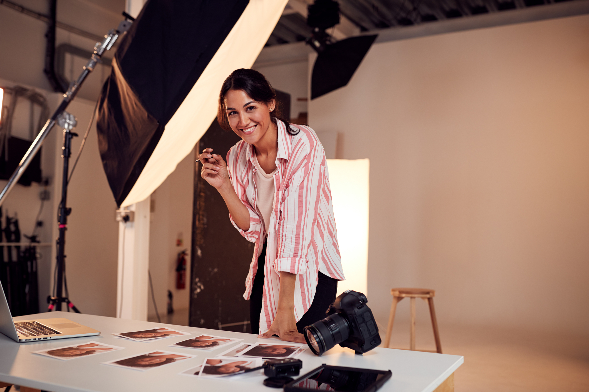 stock photo Portrait Of Female Photographer Editing Images