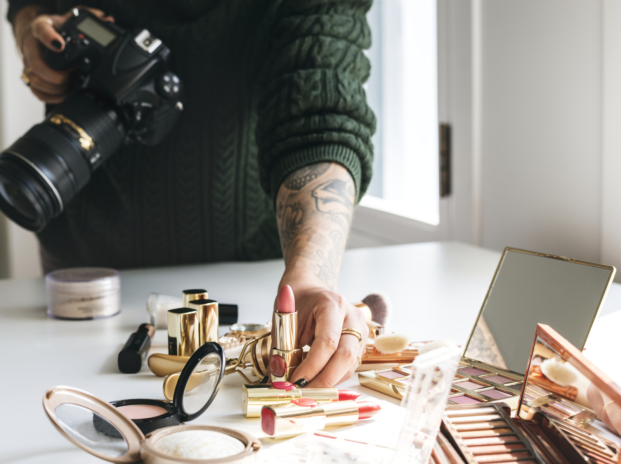 Beauty blogger taking photo of cosmetics stock image