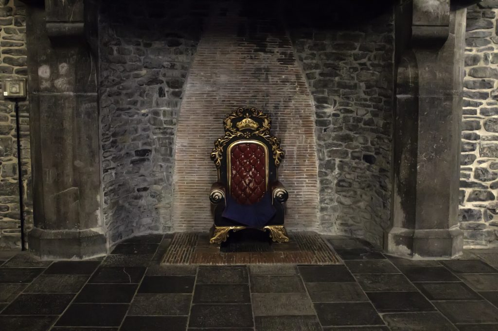 Throne in medieval castle stock photo