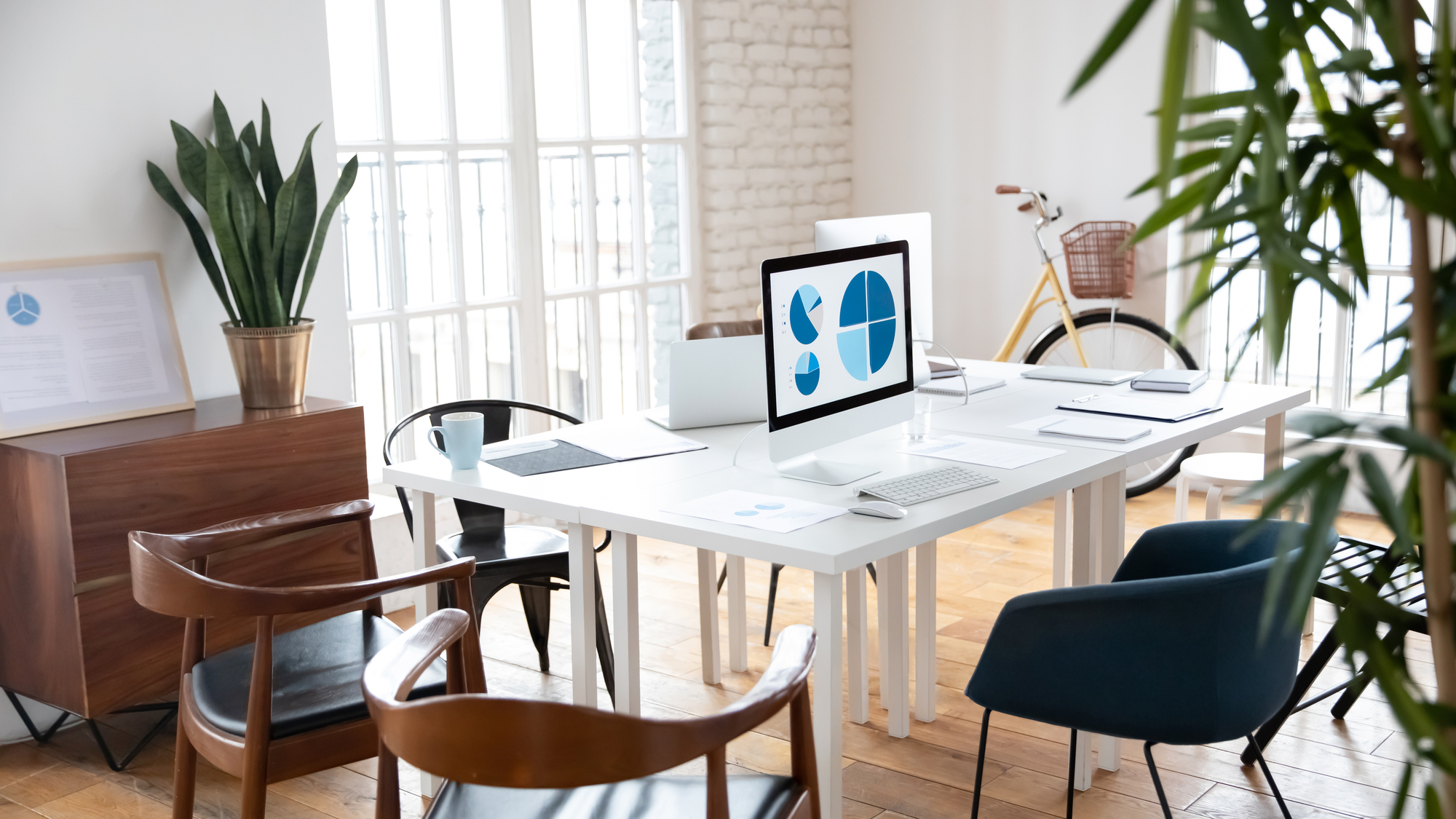 Empty loft workplace with wooden table stock photo