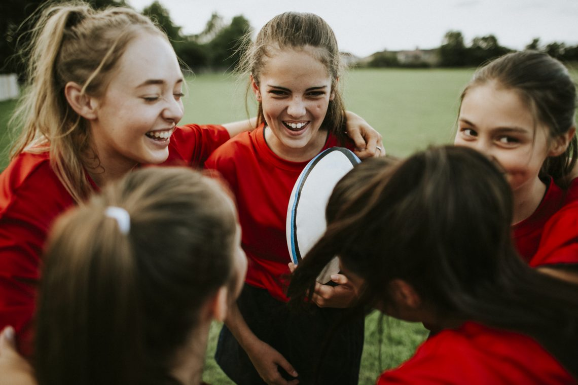 Cheerful young rugby players on the field stock image
