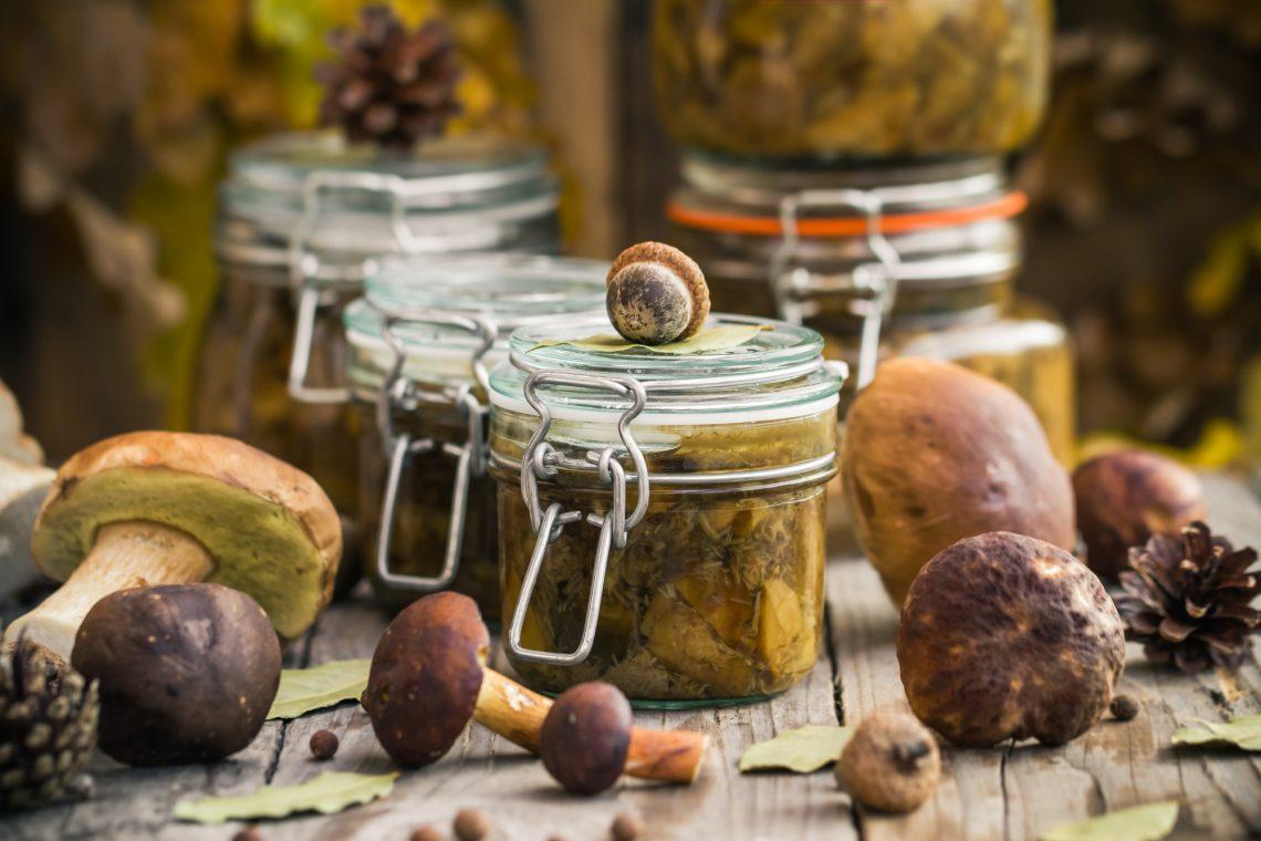 Marinated mushrooms in jars stock photo