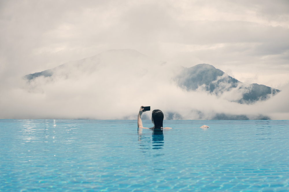 stock photo woman swimming mountain lake