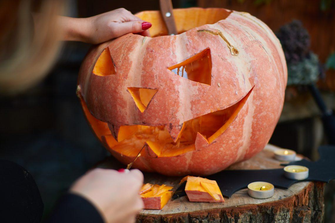 carving pumpkin stock photo