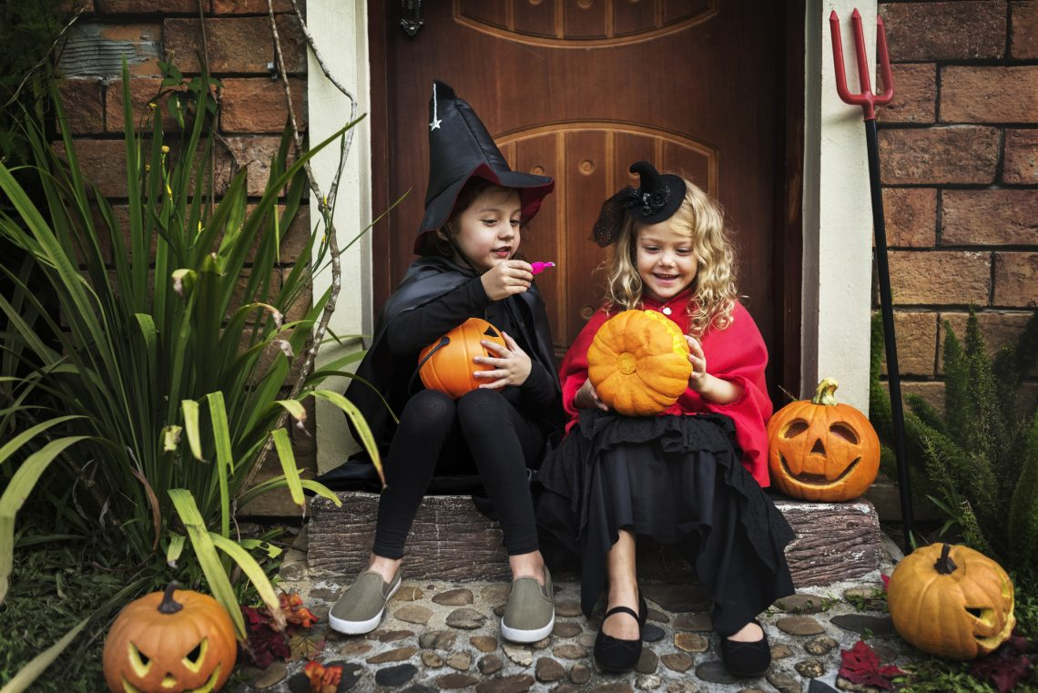Little kids at a Halloween party stock photo