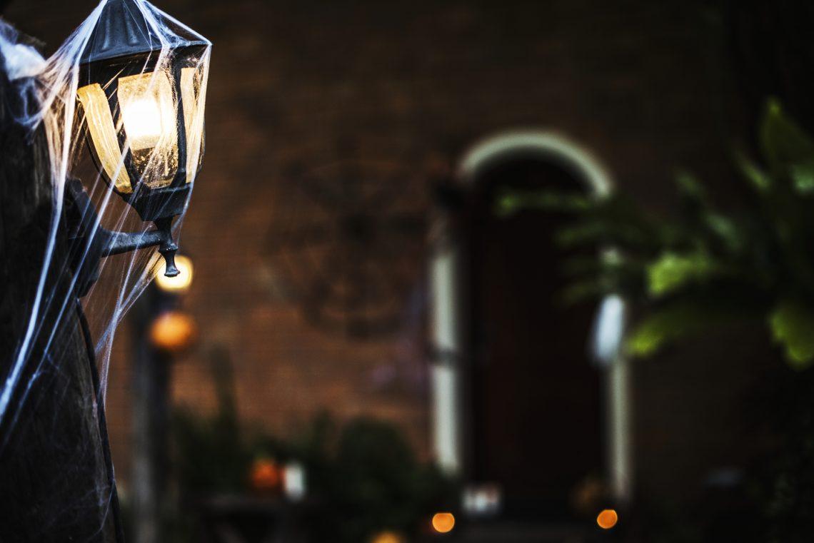 stock photo Light post with spiderweb on Halloween