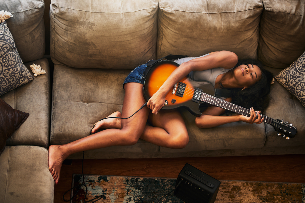 stock photo guitar girl sofa