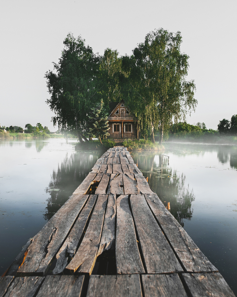 travel photography stock photo wooden house lake