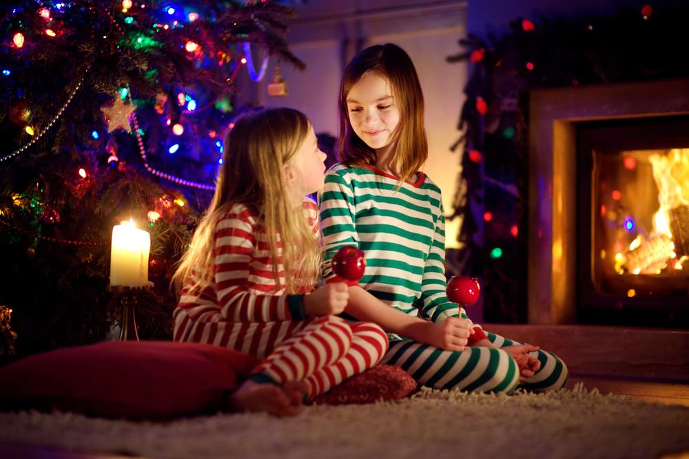 stock photo christmas girls fireplace