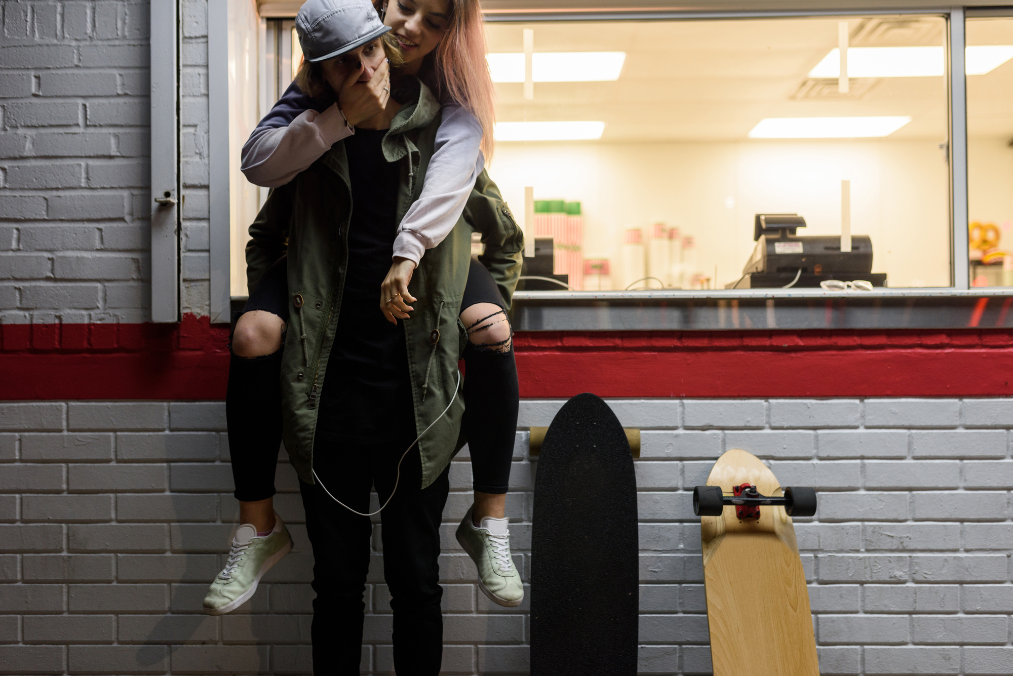 Young hipster girl on the back of her boyfriend stock photo