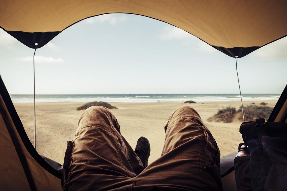 stock photo beach man tent