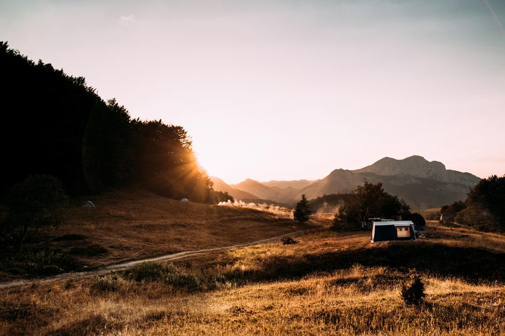 stock photo mountains sunset field