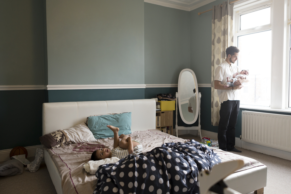 stock photo family father bedroom