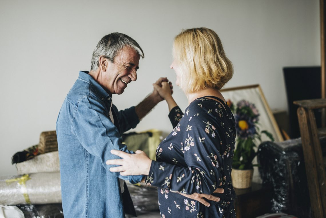 Older couple dancing stock photo