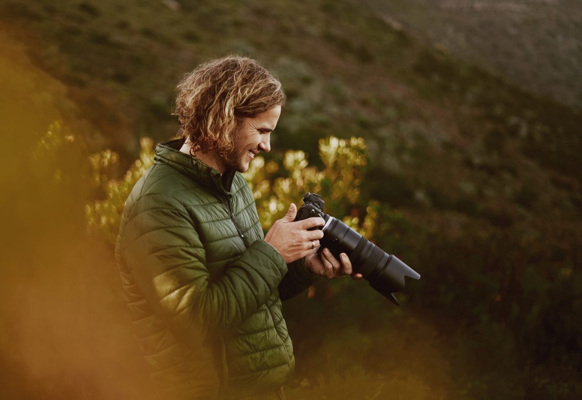 Male photographer in nature stock photo