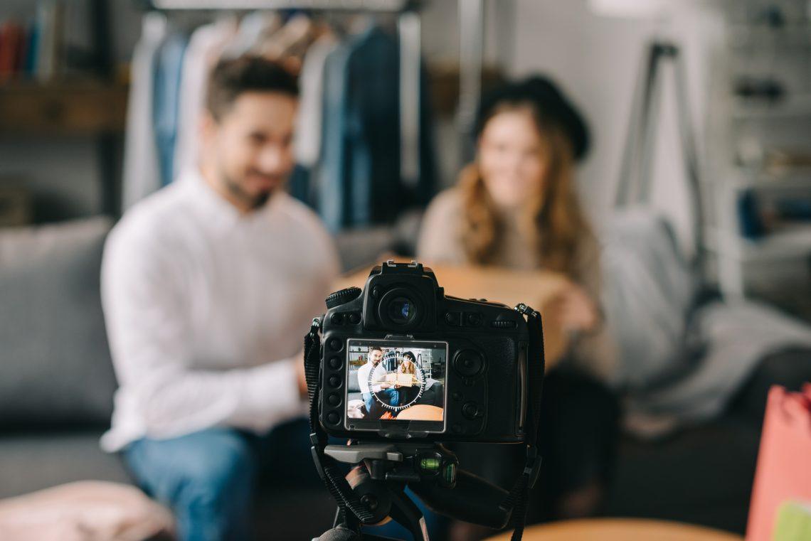 Caucasian couple filming stock photo