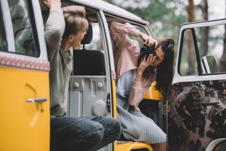 Female photographer in a van
